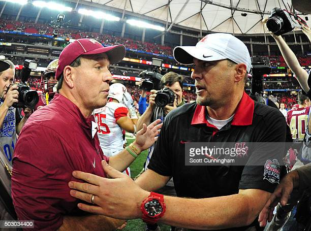 Head coach Tom Herman of the Houston Cougars is congratulated by head coach Jimbo Fisher of the Florida State Seminoles after the ChickFilA Peach...