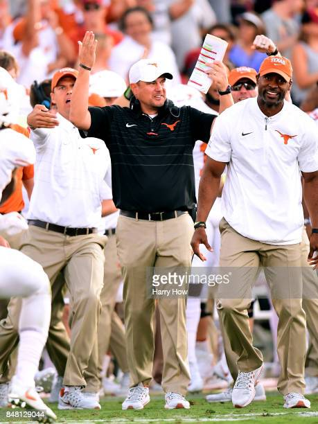 Head coach Tom Herman of the Texas Longhorns celebrates a goal line stance by his defense against the USC Trojans during the first quarter at Los...