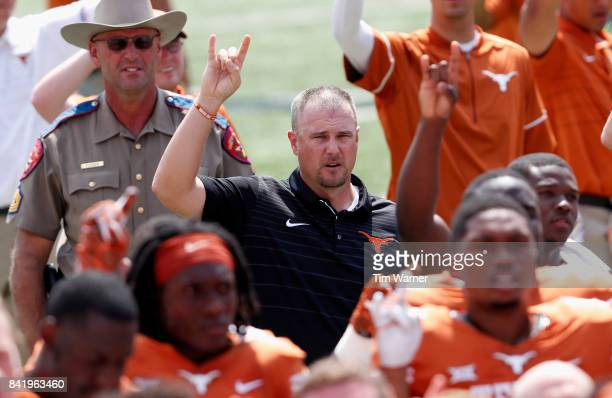 Head coach Tom Herman of the Texas Longhorns sings The Eyes of Texas following a loss to the Maryland Terrapins at Darrell K RoyalTexas Memorial...