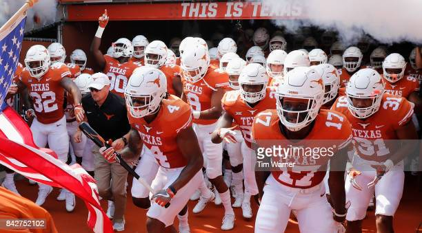 Head coach Tom Herman of the Texas Longhorns takes the field with the team before the game against the Maryland Terrapins at Darrell K RoyalTexas...