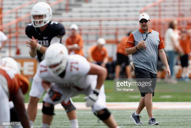 Head coach Tom Herman of the Texas Longhorns watches an offensive play during the OrangeWhite Spring Game at Darrell K RoyalTexas Memorial Stadium on...