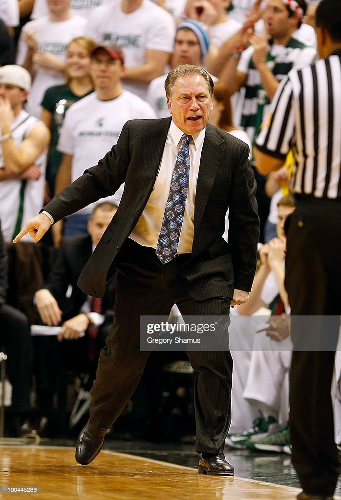 Head coach <a gi-track='captionPersonalityLinkClicked' href=/galleries/search?phrase=Tom+Izzo&family=editorial&specificpeople=238861 ng-click='$event.stopPropagation()'>Tom Izzo</a> discusses a second half play with a ref while playing the Illinois Fighting Illini at the Jack T. Breslin Student Events Center on January 31, 2013 in East Lansing, Michigan. Michigan State won the game 80-75.