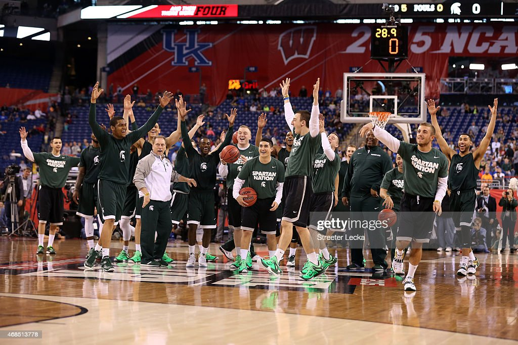 Head coach <a gi-track='captionPersonalityLinkClicked' href=/galleries/search?phrase=Tom+Izzo&family=editorial&specificpeople=238861 ng-click='$event.stopPropagation()'>Tom Izzo</a> of the Michigan State Spartans and his team react during practice for the NCAA Men's Final Four at Lucas Oil Stadium on April 3, 2015 in Indianapolis, Indiana.