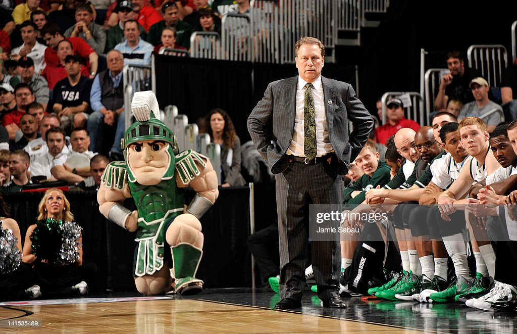 Head coach <a gi-track='captionPersonalityLinkClicked' href=/galleries/search?phrase=Tom+Izzo&family=editorial&specificpeople=238861 ng-click='$event.stopPropagation()'>Tom Izzo</a> of the Michigan State Spartans and the Michigan State Spartans mascot look on during the first half against the St. Louis Billikens during the third round of the 2012 NCAA Men's basketball tournament at Nationwide Arena on March 18, 2012 in Columbus, Ohio.