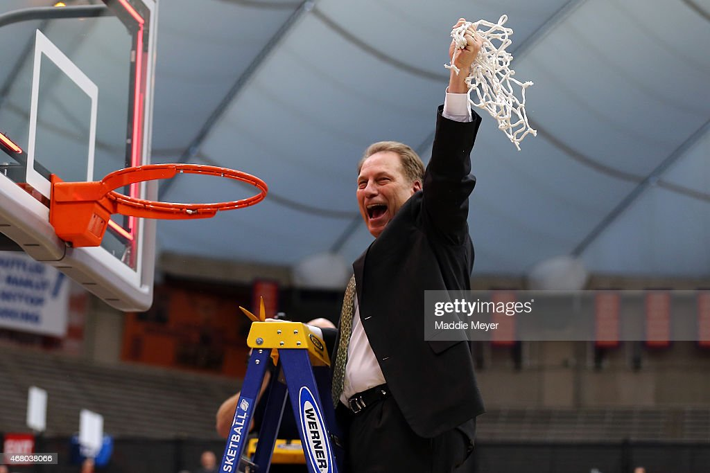 Head coach <a gi-track='captionPersonalityLinkClicked' href=/galleries/search?phrase=Tom+Izzo&family=editorial&specificpeople=238861 ng-click='$event.stopPropagation()'>Tom Izzo</a> of the Michigan State Spartans celebrates by cutting down the net after defeating the Louisville Cardinals 76 to 70 in overtime of the East Regional Final of the 2015 NCAA Men's Basketball Tournament at Carrier Dome on March 29, 2015 in Syracuse, New York.
