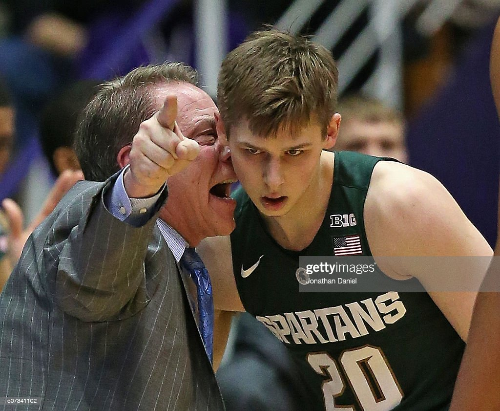 Head coach <a gi-track='captionPersonalityLinkClicked' href=/galleries/search?phrase=Tom+Izzo&family=editorial&specificpeople=238861 ng-click='$event.stopPropagation()'>Tom Izzo</a> of the Michigan State Spartans gets into the ear of Matt McQuaid #20 during a game against the Northwestern Wildcats at Welsh-Ryan Arena on January 28, 2016 in Evanston, Illinois.