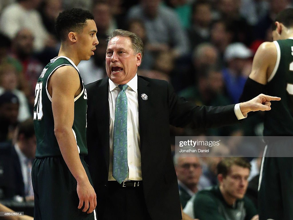 Head coach <a gi-track='captionPersonalityLinkClicked' href=/galleries/search?phrase=Tom+Izzo&family=editorial&specificpeople=238861 ng-click='$event.stopPropagation()'>Tom Izzo</a> of the Michigan State Spartans gives instructions to <a gi-track='captionPersonalityLinkClicked' href=/galleries/search?phrase=Travis+Trice&family=editorial&specificpeople=8624391 ng-click='$event.stopPropagation()'>Travis Trice</a> #20 as they take on the Wisconsin Badgers during the Championship game of the 2015 Big Ten Men's Basketball Tournament at the United Center on March 15, 2015 in Chicago, Illinois.