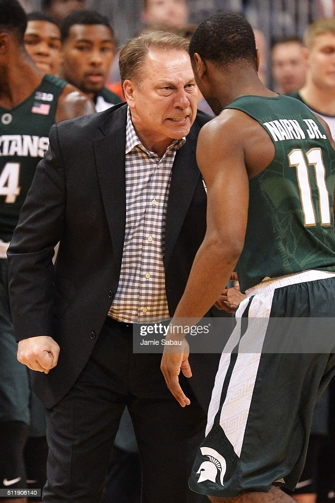 Head Coach Tom Izzo of the Michigan State Spartans gives instructions to Lourawls Nairn Jr #11 of the Michigan State Spartans during a break in the...