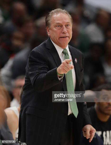 Head coach Tom Izzo of the Michigan State Spartans gives instructions to a player against the Duke Blue Devils during the State Farm Champions...