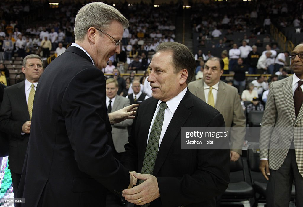 Head coach Tom Izzo of the Michigan State Spartans greets head coach Fran McCaffery of the Iowa Hawkeyes before their match-up on January 10, 2013 at Carver-Hawkeye Arena in Iowa City, Iowa.