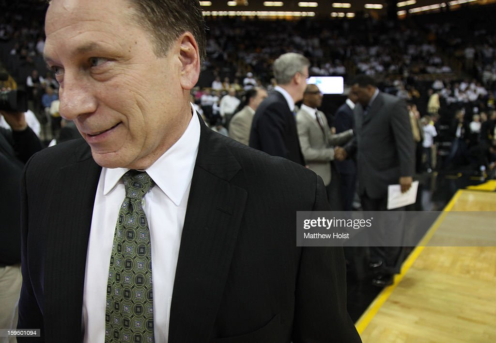 Head coach <a gi-track='captionPersonalityLinkClicked' href=/galleries/search?phrase=Tom+Izzo&family=editorial&specificpeople=238861 ng-click='$event.stopPropagation()'>Tom Izzo</a> of the Michigan State Spartans smiles as he walks onto the court for the match-up against the Iowa Hawkeyes on January 10, 2013 at Carver-Hawkeye Arena in Iowa City, Iowa. Michigan State won 62-59.