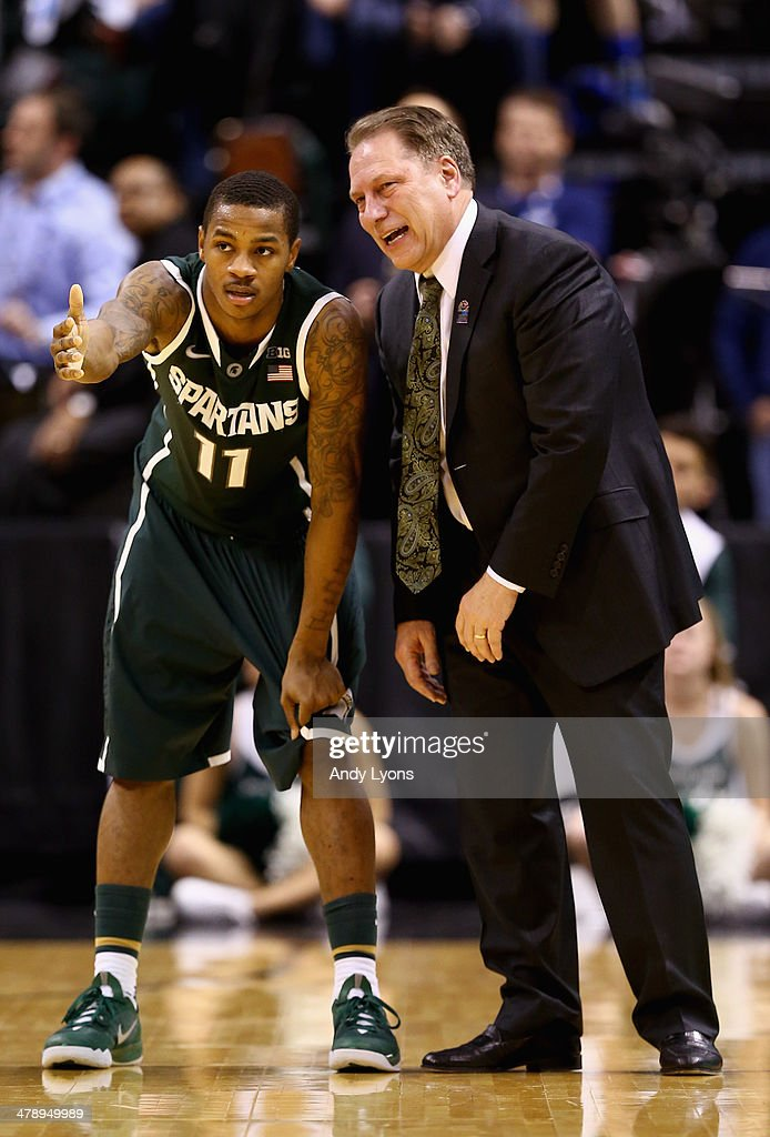 Head coach <a gi-track='captionPersonalityLinkClicked' href=/galleries/search?phrase=Tom+Izzo&family=editorial&specificpeople=238861 ng-click='$event.stopPropagation()'>Tom Izzo</a> of the Michigan State Spartans speaks to <a gi-track='captionPersonalityLinkClicked' href=/galleries/search?phrase=Keith+Appling&family=editorial&specificpeople=7367720 ng-click='$event.stopPropagation()'>Keith Appling</a> #11 during the second half of the Big Ten Basketball Tournament Semifinal game against the Wisconsin Badgers at Bankers Life Fieldhouse on March 15, 2014 in Indianapolis, Indiana.