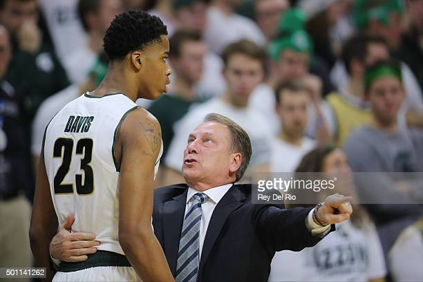 Head coach Tom Izzo of the Michigan State Spartans talks to Deyonta Davis of the Michigan State Spartans in the first half at the Breslin Center on...