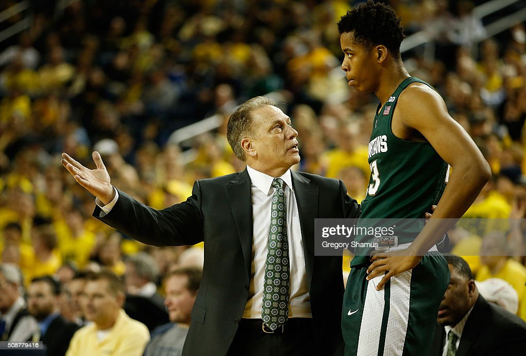Head coach <a gi-track='captionPersonalityLinkClicked' href=/galleries/search?phrase=Tom+Izzo&family=editorial&specificpeople=238861 ng-click='$event.stopPropagation()'>Tom Izzo</a> of the Michigan State Spartans talks with <a gi-track='captionPersonalityLinkClicked' href=/galleries/search?phrase=Deyonta+Davis&family=editorial&specificpeople=14247809 ng-click='$event.stopPropagation()'>Deyonta Davis</a> #23 while playing the Michigan Wolverines at Crisler Center on January 6, 2016 in Ann Arbor, Michigan.