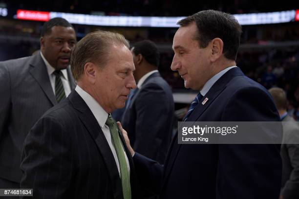 Head coach Tom Izzo of the Michigan State Spartans talks with head coach Mike Krzyzewski of the Duke Blue Devils prior to their game during the...