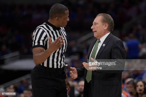 Head coach Tom Izzo of the Michigan State Spartans talks with referee Ted Valentine during the game against the Duke Blue Devils during the Champions...