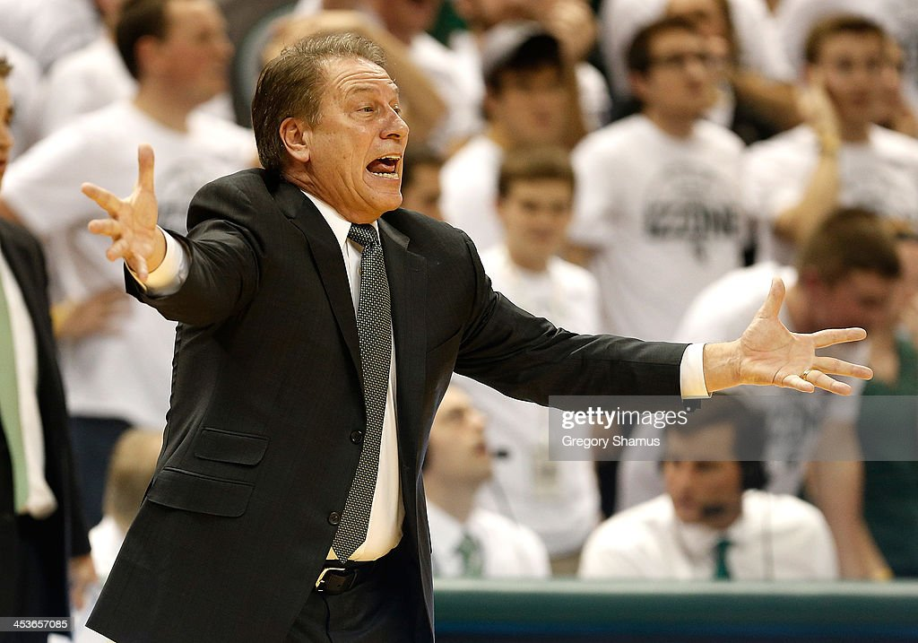 Head coach <a gi-track='captionPersonalityLinkClicked' href=/galleries/search?phrase=Tom+Izzo&family=editorial&specificpeople=238861 ng-click='$event.stopPropagation()'>Tom Izzo</a> of the Michigan State Spartans yells from the bench in the fist half while playing the North Carolina Tar Heels at the Jack T. Breslin Student Events Center on December 4, 2013 in East Lansing, Michigan. North Carolina won the game 79-65.