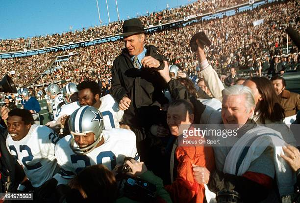 Head Coach Tom Landry of the Dallas Cowboys gets carried off the field by his players after they defeated the Miami Dolphins in Super Bowl VI at...