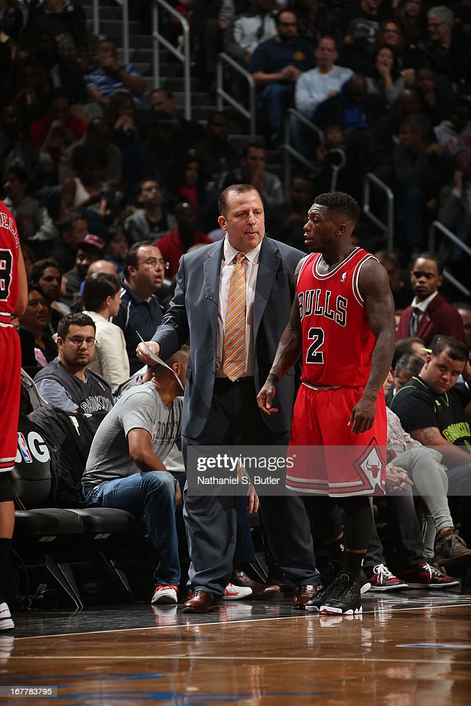 Head Coach Tom Thibodeau and Nate Robinson #2 of the Chicago Bulls have a conversation against the Brooklyn Nets in Game Five of the Eastern Conference Quarterfinals during the 2013 NBA Playoffs on April 29 at the Barclays Center in the Brooklyn borough of New York City.