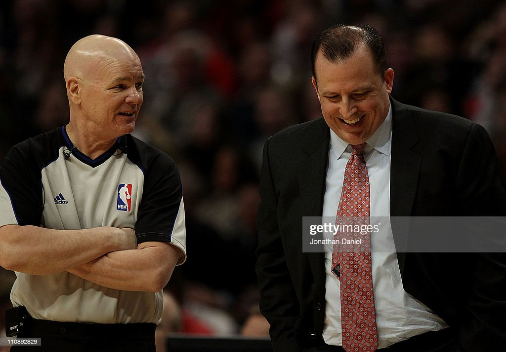Head coach Tom Thibodeau of the Chicago Bulls laughs at a comment made by referee Joey Crawford during a game against the Memphis Girzzlies at the United Center on March 25, 2011 in Chicago, Illinois.