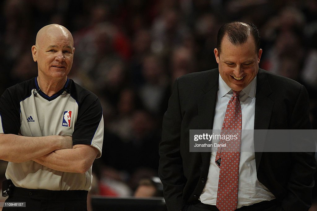 Head coach Tom Thibodeau of the Chicago Bulls laughs at a comment made by referee Joey Crawford during a game against the Memphis Girzzlies at the United Center on March 25, 2011 in Chicago, Illinois. The Bulls defeated the Grizzlies 99-96.