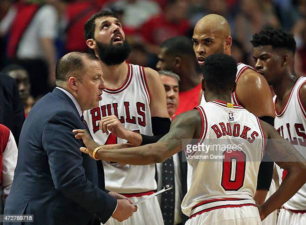 Head coach Tom Thibodeau of the Chicago Bulls talks with Nikola Mirotic Aaron Brooks Taj Gibson and Jimmy Butler during a break against the Cleveland...