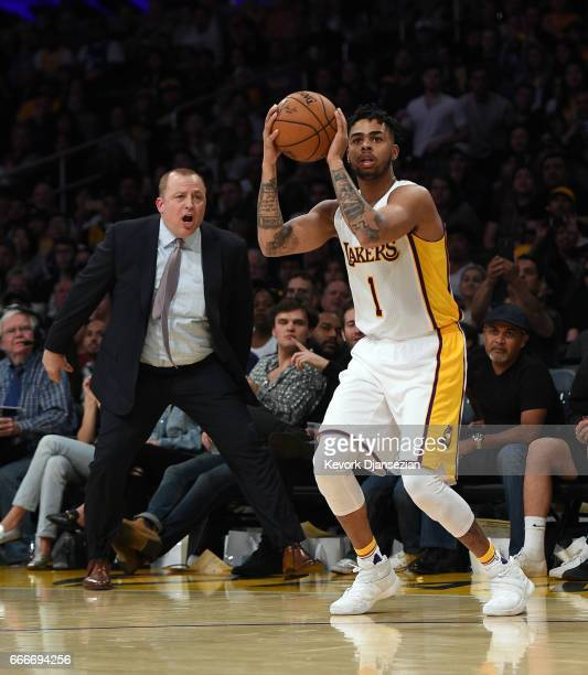 Head coach Tom Thibodeau of the Minnesota Timberwolves yells in an attempt to disturb D'Angelo Russell of the Los Angeles Lakers threepoint basket...