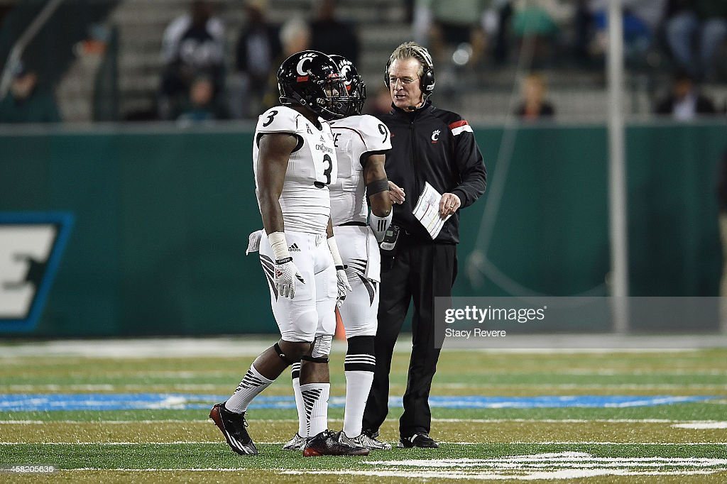 Head coach Tommy Tuberville of the Cincinnati Bearcats speaks with his players during a timeout against the Tulane Green Wave at Yulman Stadium on October 31, 2014 in New Orleans, Louisiana.