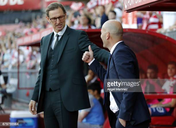 Head coach Tony Adams of Granada CF greets head coach Zinedine Zidane of Real Madrid prior to the La Liga match between Granada CF and Real Madrid CF...
