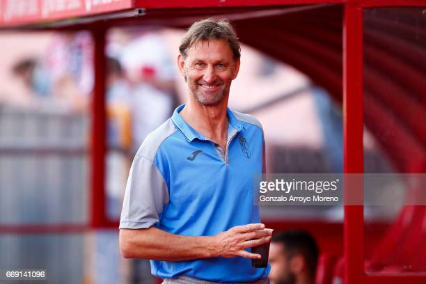 Head coach Tony Adams of Granada CF smiles as he comes from the bench before the La Liga match between Granada CF and Real Club Celta de Vigo at...