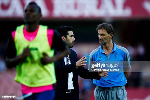 Head coach Tony Adams of Granada CF speaks with assistant coach Manuel Lucena as Uche Henry Agbo leaves the pitch during the La Liga match between...