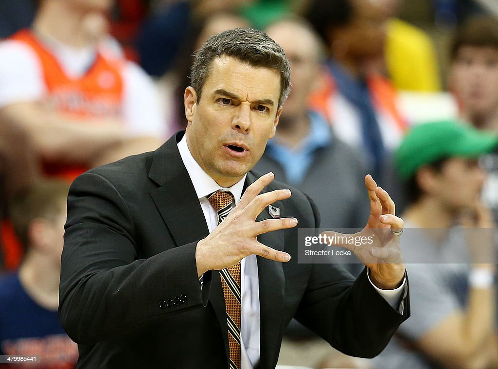Head coach Tony Bennett of the Virginia Cavaliers reacts in the second half against the Coastal Carolina Chanticleers during the Second Round of the 2014 NCAA Basketball Tournament at PNC Arena on March 21, 2014 in Raleigh, North Carolina.