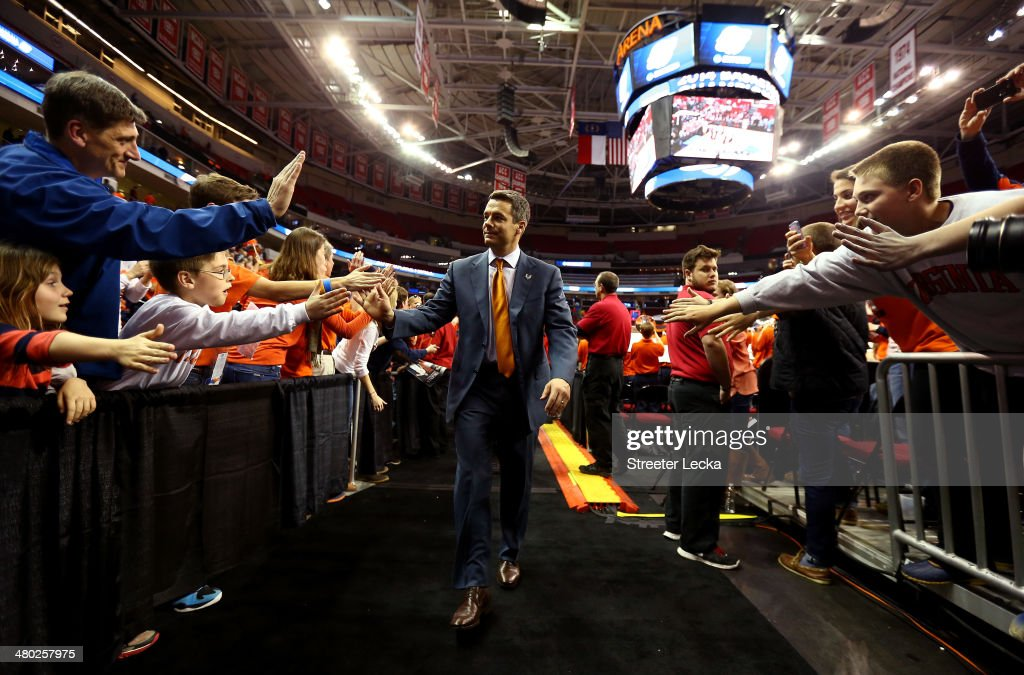 Head coach Tony Bennett of the Virginia Cavaliers walks off the court after defeating the Memphis Tigers during the third round of the 2014 NCAA...