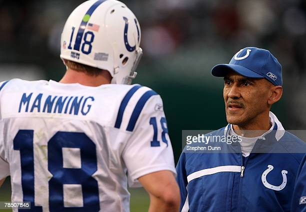 Head coach Tony Dungy and quarterback Peyton Manning of the Indianapolis Colts confer during the game against the Oakland Raiders at McAfee Coliseum...
