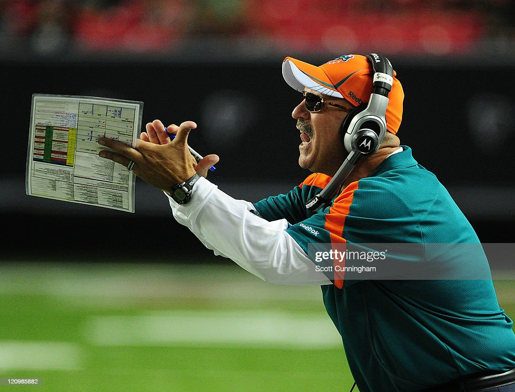 Head Coach <a gi-track='captionPersonalityLinkClicked' href=/galleries/search?phrase=Tony+Sparano&family=editorial&specificpeople=756487 ng-click='$event.stopPropagation()'>Tony Sparano</a> of the Miami Dolphins reacts to a play against the Atlanta Falcons during a preseason game at the Georgia Dome on August 12, 2011 in Atlanta, Georgia.