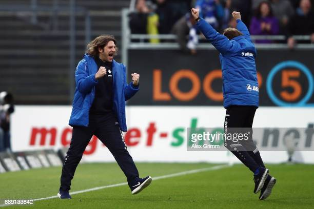 Head coach Torsten Frings and assistant coach Bjoern Mueller of Darmstadt celebrate the last minute winning goal during the Bundesliga match between...