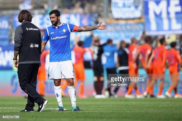 Head coach Torsten Frings and team captain Aytac Sulu of Darmstadt discuss after the Second Bundesliga match between SV Darmstadt 98 and VfL Bochum...