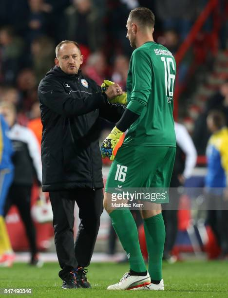 Head coach Torsten Lieberknecht of Braunschweig and goalkeeper Jasmin Fejzic look on after the Second Bundesliga match between 1 FC Union Berlin and...