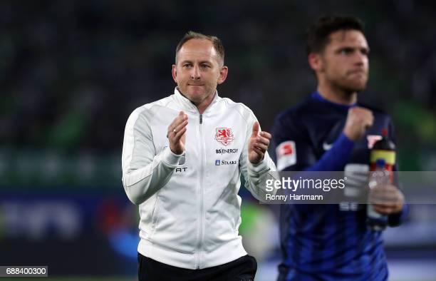 Head coach Torsten Lieberknecht of Braunschweig applauds the fans after the Bundesliga Playoff first leg match between VfL Wolfsburg and Eintracht...