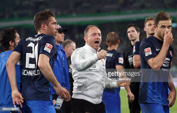 Head coach Torsten Lieberknecht of Braunschweig reacts next to Patrick Schoenfeld and Ken Reichel of Braunschweig after the Bundesliga Playoff first...