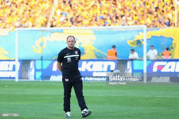 Head coach Torsten Lieberknecht of Braunschweig walks over the pitch prior to the Bundesliga Playoff leg 2 match between Eintracht Braunschweig and...