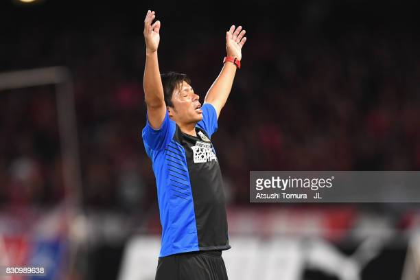 Head coach Toru Oniki of Kawasaki Frontale celebrates after his side's 31 victory during the JLeague J1 match between Kawasaki Frontale and Kashima...