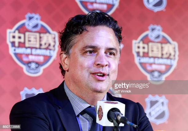 Head coach Travis Green of the Vancouver Canucks answers questions during a press conference after the preseason game between the Vancouver Canucks...