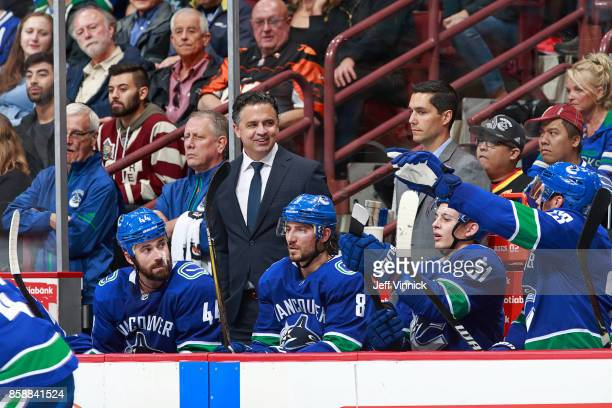 Head coach Travis Green of the Vancouver Canucks looks on from the bench during his NHL game against the Edmonton Oilers at Rogers Arena October 7...