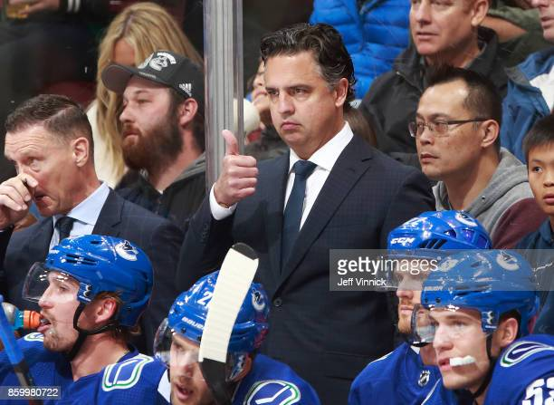 Head coach Travis Green of the Vancouver Canucks looks on from the bench during their NHL game against the Edmonton Oilers at Rogers Arena October 7...