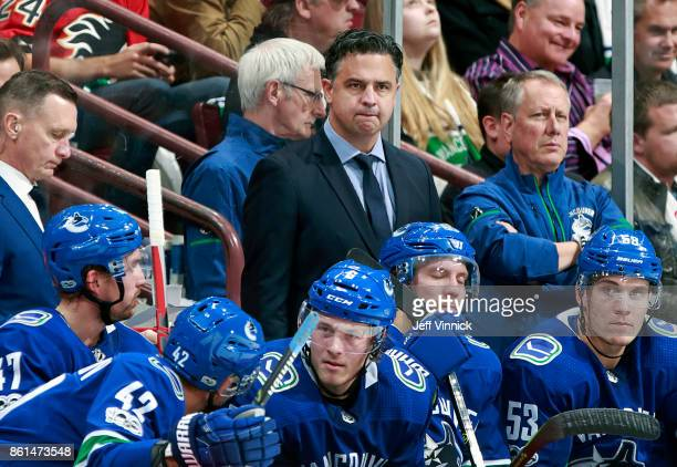 Head coach Travis Green of the Vancouver Canucks looks on from the bench during their NHL game against the Calgary Flames at Rogers Arena October 14...