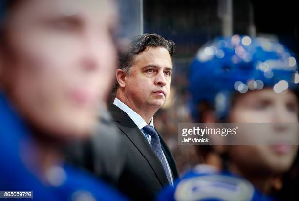Head coach Travis Green of the Vancouver Canucks looks on from the bench during their NHL game against the Ottawa Senators at Rogers Arena October 10...