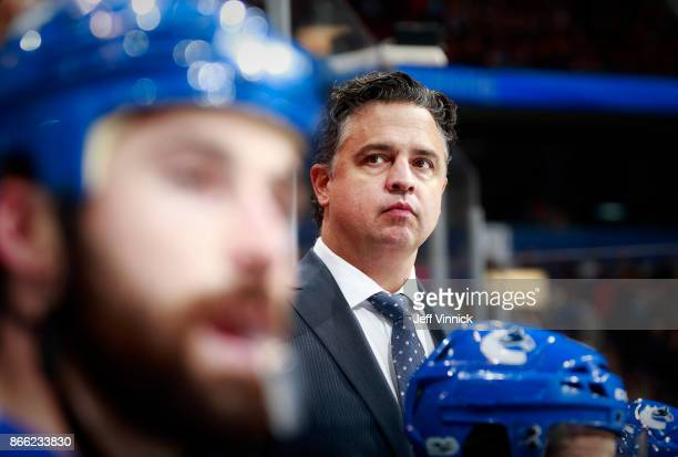 Head coach Travis Green of the Vancouver Canucks looks on from the bench during their NHL game against the Winnipeg Jets at Rogers Arena October 12...