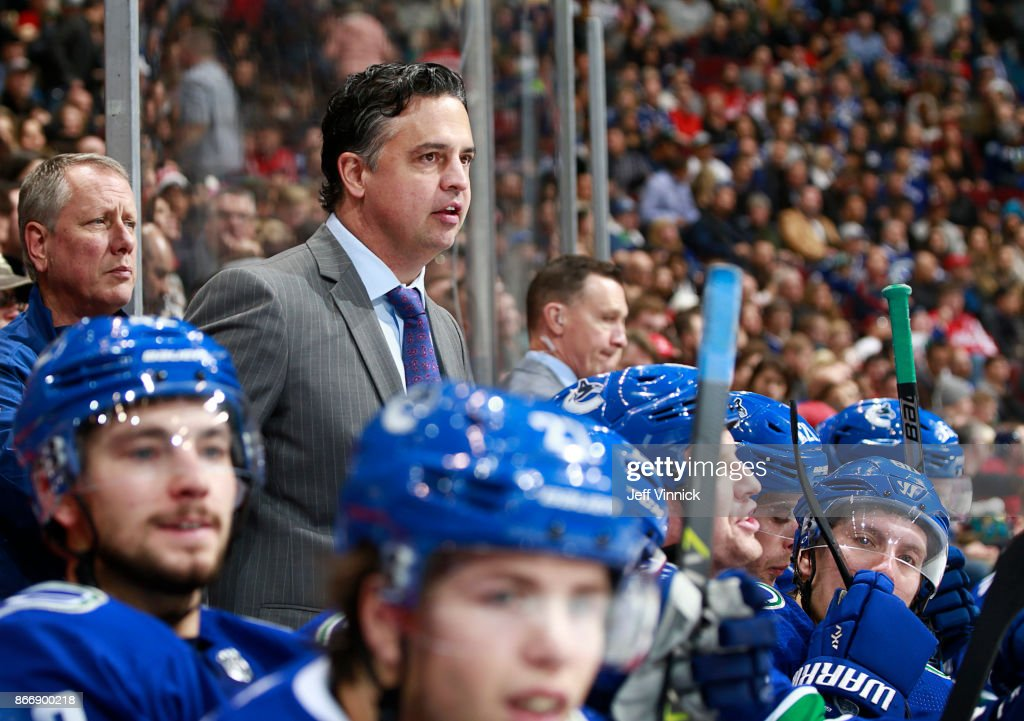 Head coach Travis Green of the Vancouver Canucks looks on from the bench during their NHL game against the Washington Capitals at Rogers Arena October 26, 2017 in Vancouver, British Columbia, Canada. Vancouver won 6-2.