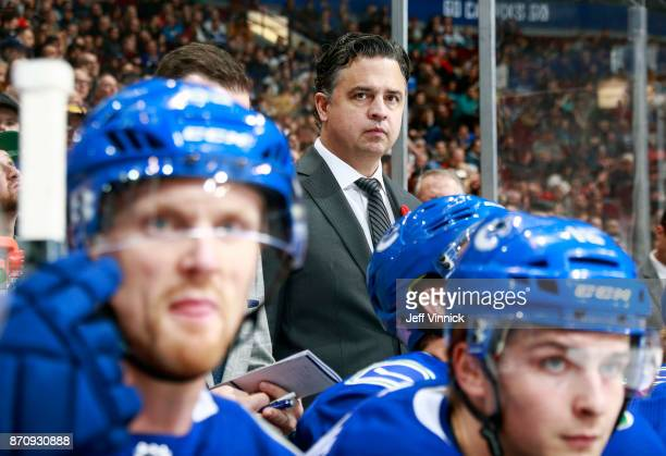 Head coach Travis Green of the Vancouver Canucks looks on from the bench during their NHL game against the New Jersey Devils at Rogers Arena November...